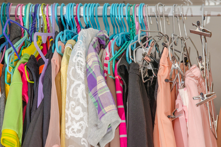 untidy: Untidy cluttered woman wardrobe with colorful clothes and accessories.