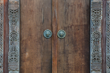 Wooden door with ancient floral patten. Wood carving technic. Reklamní fotografie