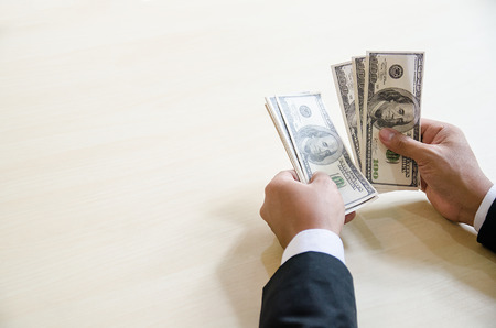 Close Up Business Man Hands Count Hundred Dollar Bills with copy spcae for label text Reklamní fotografie