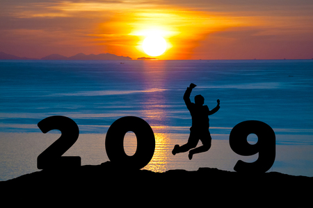 Newyear 2019 concept Silhouette young businessman jumping to 2019 new year