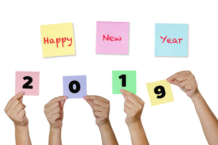 Woman hand hold Paper notes with label Happy New Year 2019 (A New year coming concept)