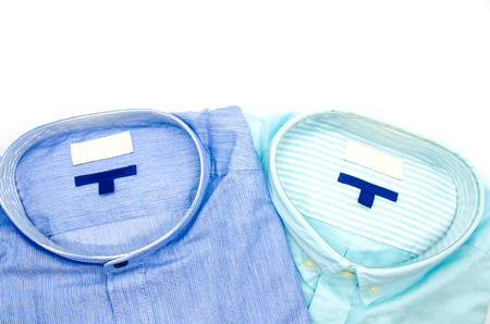 Classic mens shirts stacked isolated on a white background