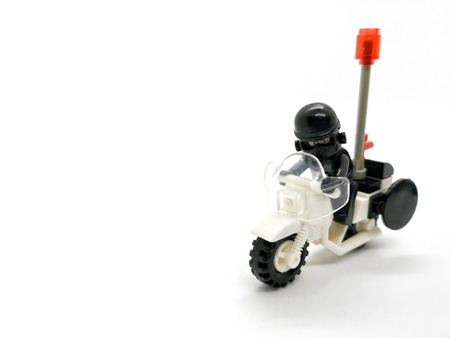 isolate model toy of the police cop ride motorcycle on white background Stock Photo