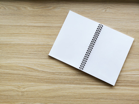 Photo blank book cover on a textured wood background Reklamní fotografie