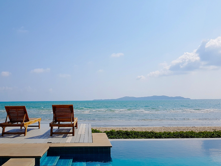 Sundeck or bench on Sea view with private swimming pool for vacation at summer time and beautiful clear sky in background, Beach lounge.