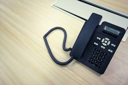 Black IP Phone, Office phone on the modern table in the meeting room. Imagens