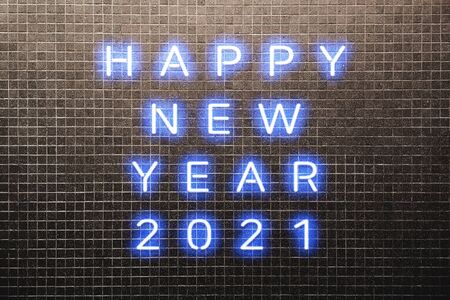 2021 Happy New Year concept with colorful blue neon lights. Design elements for presentations, flyers, cards, leaflets, posters or postcards. Isolated on dark Brown Mosaic Brick Wall background Reklamní fotografie