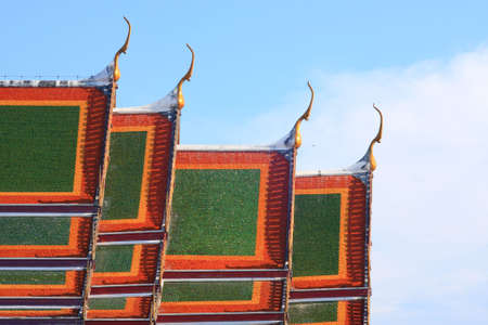 Traditional Thai style on temples roof photo