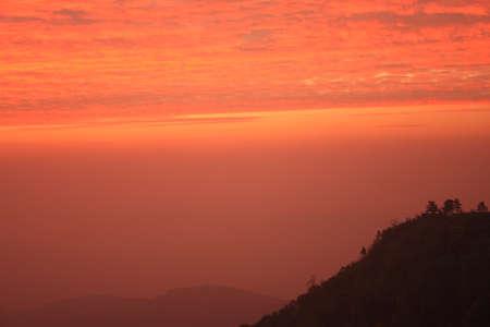 Sunrise behind mountain photo