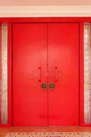 Red chinese door with lion head photo
