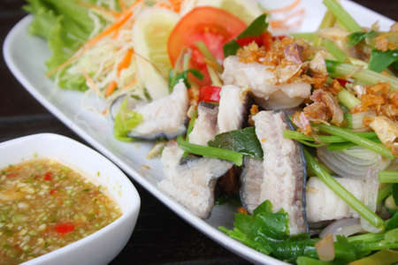 Spicy boiled fish thai style food  photo