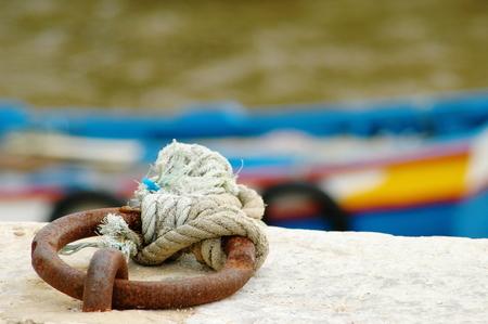moored: Blue wood fishing boat moored Stock Photo