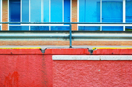 public hospital: Exterior wall of a public hospital with vivid red and blue colors
