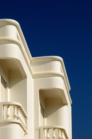 White traditional portuguese building white balconies