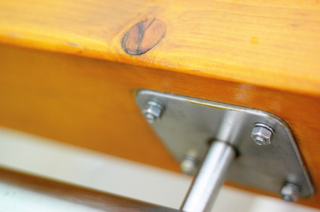 metal handrail: Wood handrail clodeup with metal piece and bolts