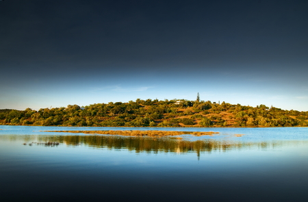 Late afternoon view of the arade river bank near Portimo, Algarve, Portugal
