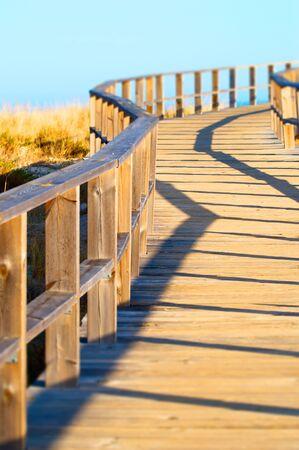 natual: Wood bridge in a natual park leading to the beach