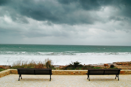 Two bench in a stormy day facing the sea Reklamní fotografie