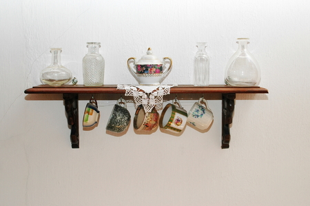 Old tableware on a very old wood shelf