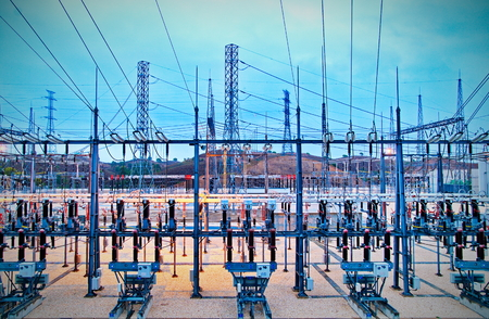 megawatt: Power station for making Electricity. Shot before sunrise with cable red hot