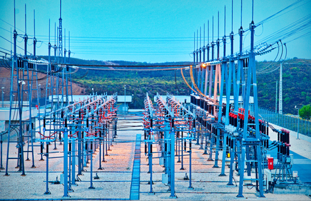isolator high voltage: Power station for making Electricity. Shot before sunrise with cable red hot