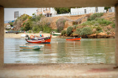 Fishing boats moored in the river at Ferragudo, Portugal
