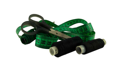 Isolated measuring green leather tape and scissors on a white background