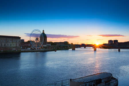 church architecture: Sunset over the bridge at Toulouse city