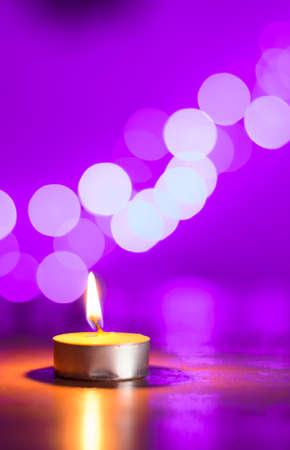 tea candle: Tea candle and a pink bokeh