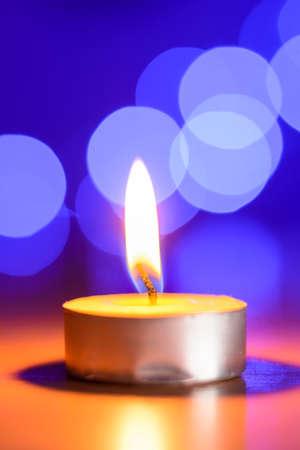 tea candle: Tea candle and a blue bokeh