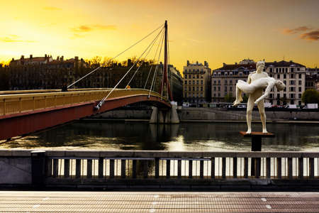 lyon: Statue and footbridge at Lyon city, France Stock Photo
