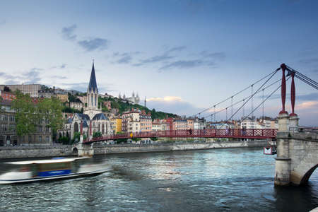Footbridge and view of old city of Lyon before sunset, France Stock Photo