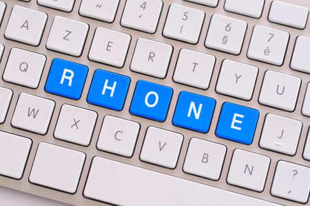 clic: Rhone in blue on white keyboard