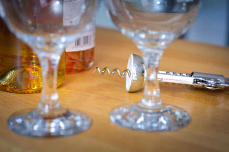 oenology: Corkscrew with glasses and bottles of wine