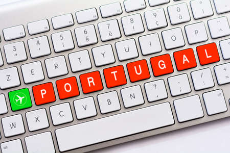 PORTUGAL writing on white keyboard with a aircraft sketch