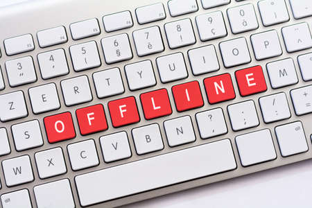 offline: OFFLINE writing on white keyboard Stock Photo