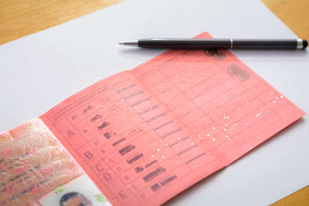 licence: Inside a french driver licence with a pen
