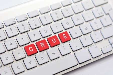 crus: CRUS writing on white keyboard Stock Photo