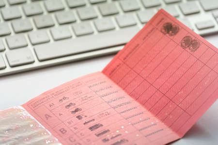 licence: Inside a french driver licence and white keyboard Stock Photo