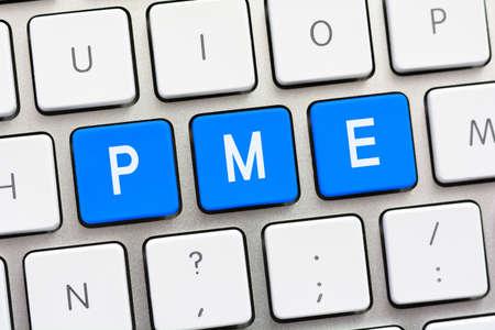 PME writing on white keyboard