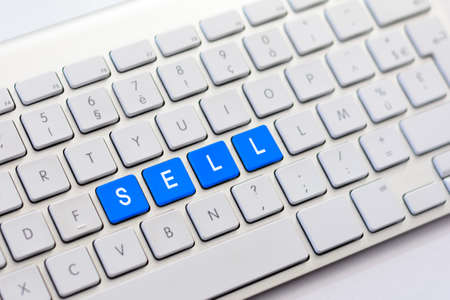 sell: SELL writing on white keyboard