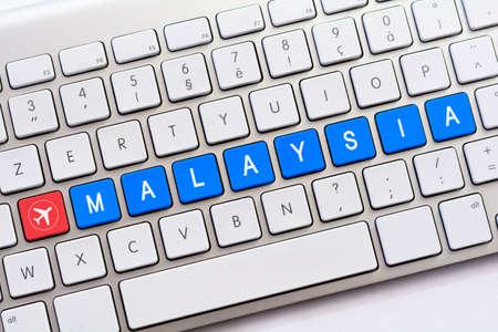 malaya: MALAYSIA writing on white keyboard with a aircraft sketch Stock Photo