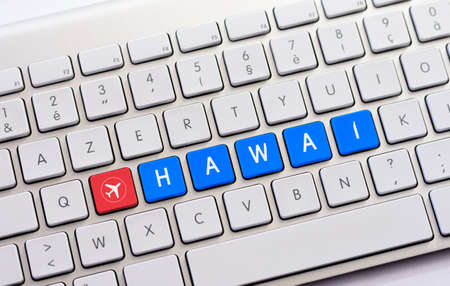 HAWAI writing on white keyboard with a aircraft sketch