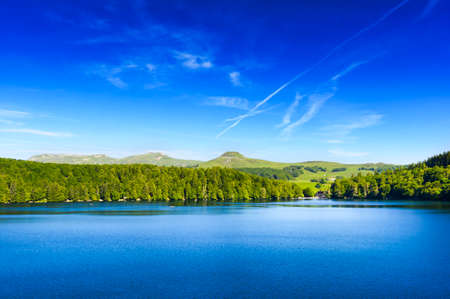 aura: Landscape of Lake Pavin in Auvergne during a beautiful day, France