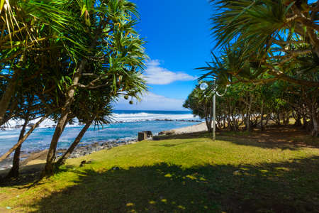 Beach at Grande Anse place, Reunion Island during a sunny day Stock Photo
