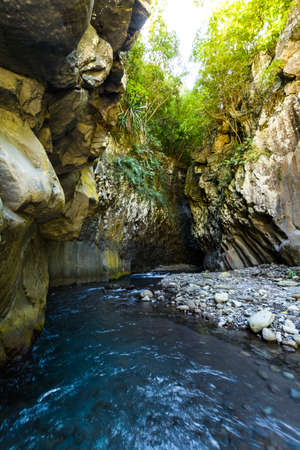 Hiking in a canyon during a sunny day, Bras de La Plain at Reunion Island Stock Photo