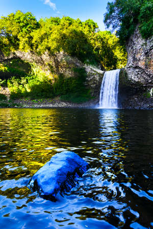 Waterfall of Bassin La Paix at Reunion Island during a sunny day Stock Photo