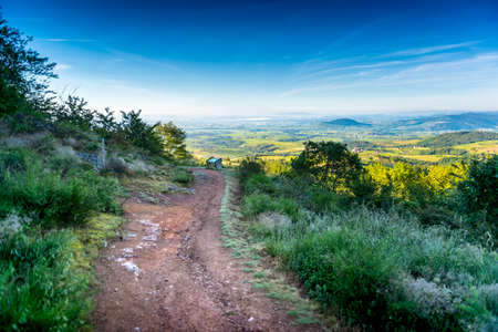 Brouilly mount and landscape of Beaujolais from Chiroubles hiking path, France 版權商用圖片