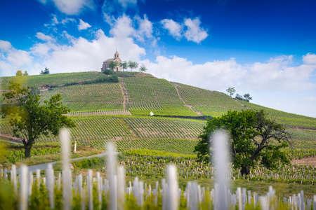 Church of Fleurie village and vineyards of Beaujolais, France 版權商用圖片