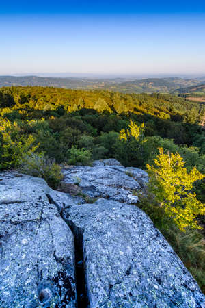 First lights of the day on the rock, Roche d Ajoux, Beaujolais, France
